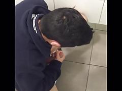 Latin schoolboy jacks off huge cock in bathroom